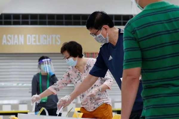 Reportan largas filas en elecciones de Singapur